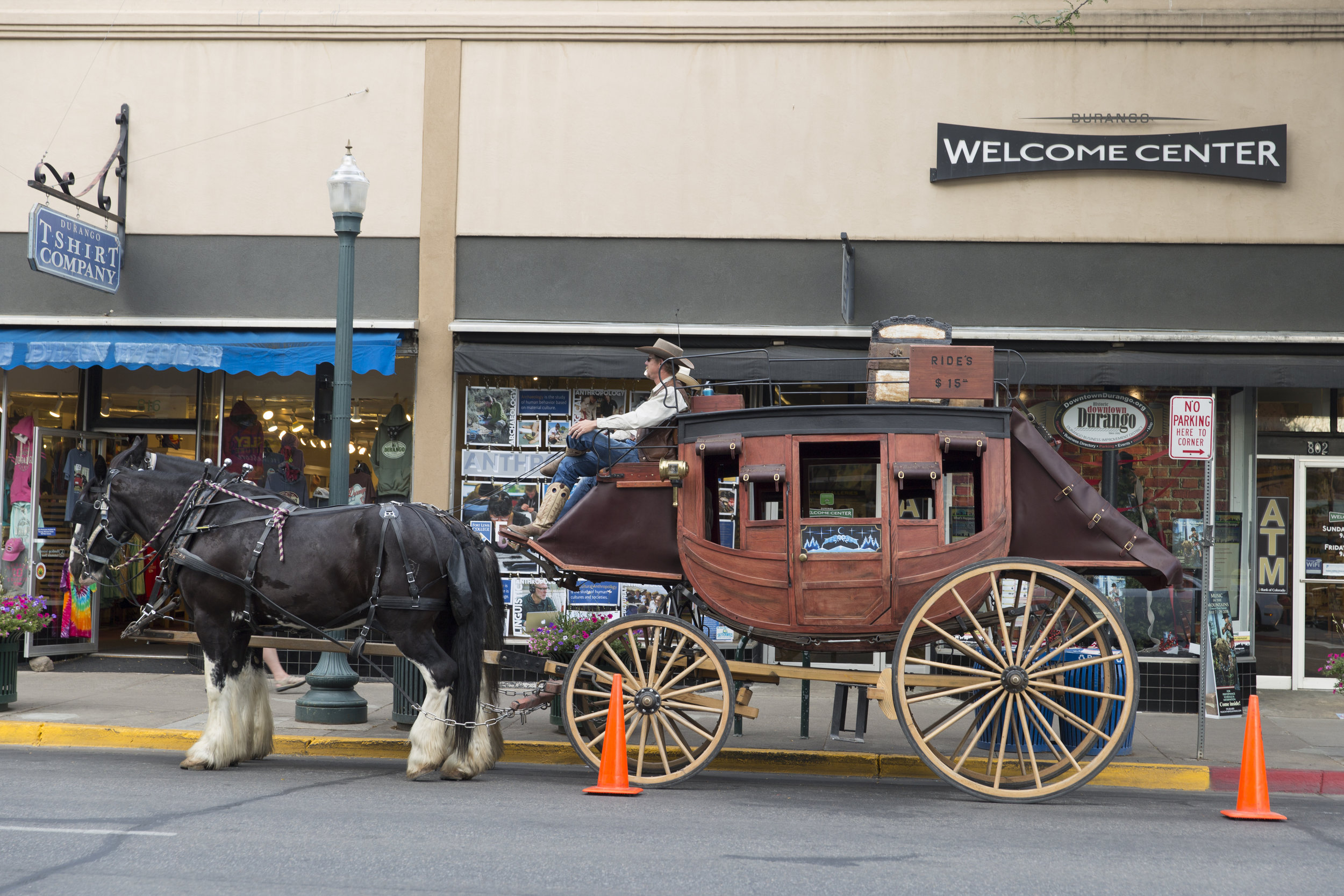 Old West attractions, such as this classic stagecoach, keep Durango's economy humming. But a growing population of homeless people and persistent panhandlers put a chill on the tourism industry, which led city officials to enact bans on sitting or lying on the streets. (Scott DW Smith, Special to The Colorado Sun)