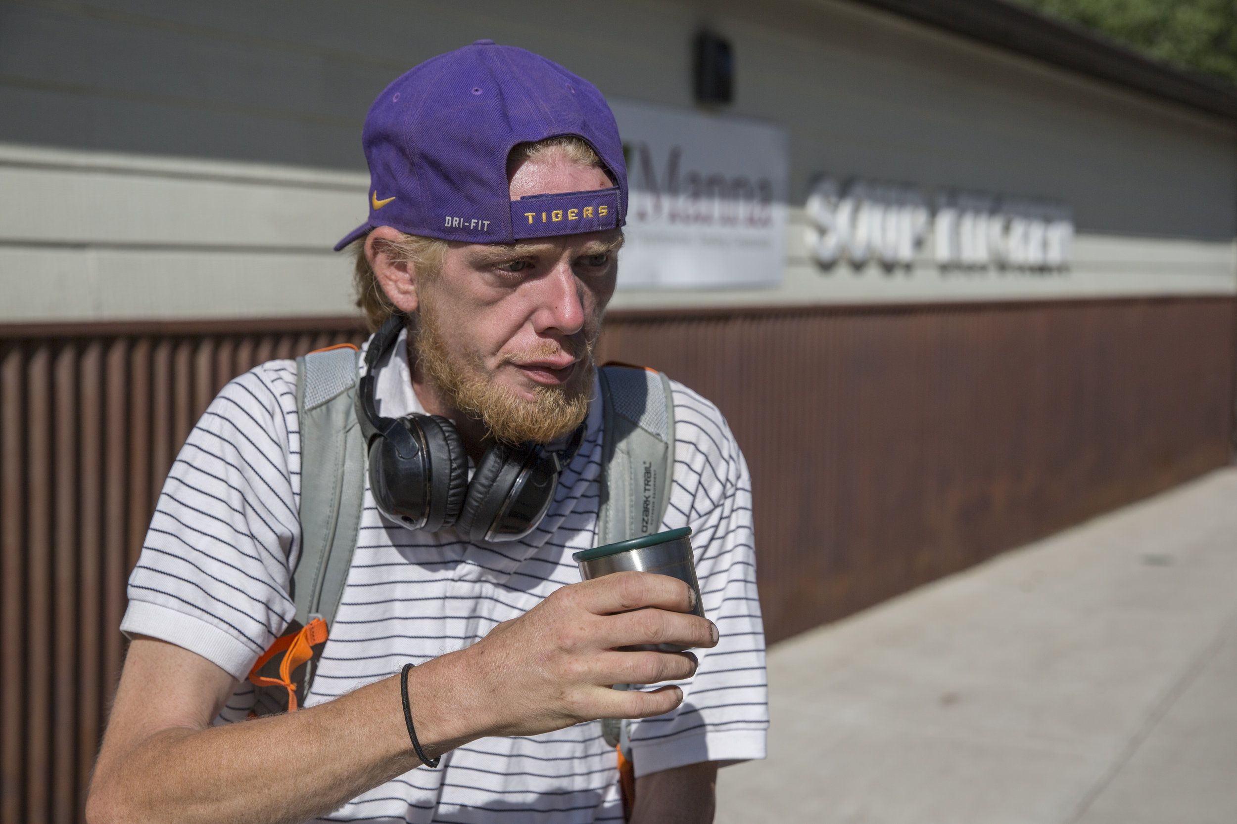 "Corey Davis, drinking his morning coffee at the Manna Soup Kitchen in Durango, left the city for a shared apartment on Colorado's Eastern Plains after a campground used by homeless people was shut down. He says he may to return to Durango. ""It's so beautiful."" (Scott DW Smith, Special to The Colorado Sun)"