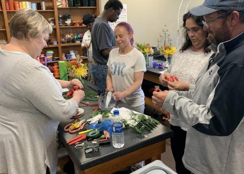 This March photo shows students at Oklahoma State University-Oklahoma City during a floral design class. The school partnered with the Curbside Chronicle to provide a certificate to selected vendors, but the in-person class has been canceled due to the coronavirus. Photo by OSU-OKC