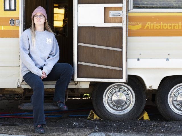 "Nurse Becky Cherney helps run Operation Face Shield out of a 1976 Bendix Aristocrat camper trailer parked behind a distillery in Ann Arbor, Michigan. The project coordinates the production of medical face shields made with 3D printers. ""It made me realize who I was again,"" she says. Photo by Elliott Woods"