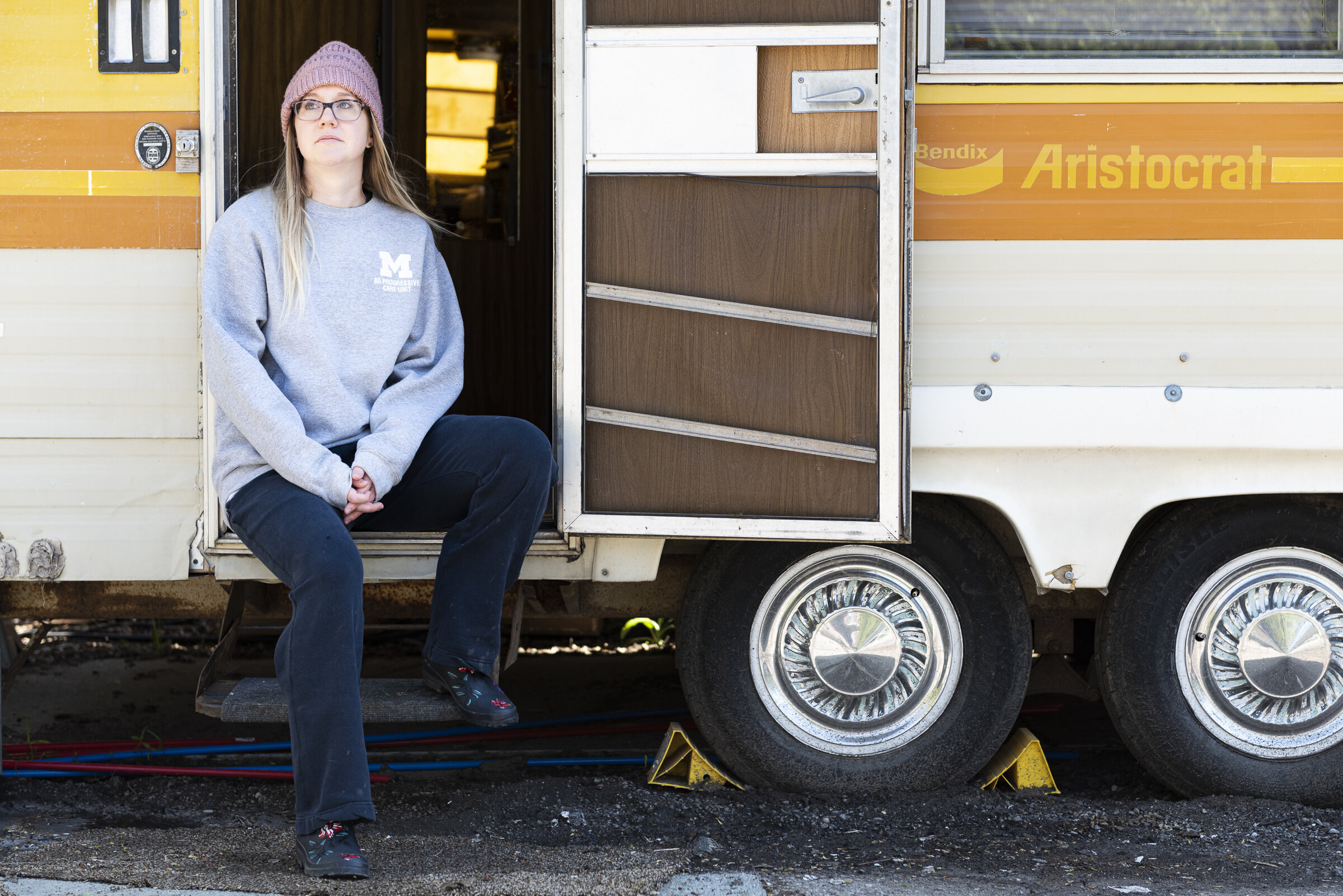 """Nurse Becky Cherney helps run Operation Face Shield out of a 1976 Bendix Aristocrat camper trailer parked behind a distillery in Ann Arbor, Michigan. The project coordinates the production of medical face shields made with 3D printers. """"It made me realize who I was again,"""" she says. Photo by Elliott Woods"""